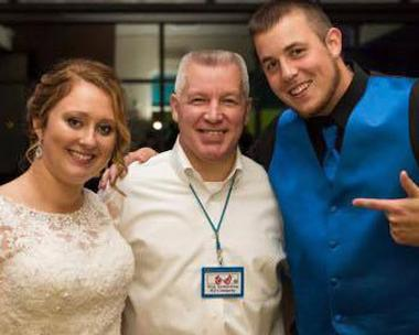 PICTURE OF TROY ARMSTONG AND WEDDING COUPLE